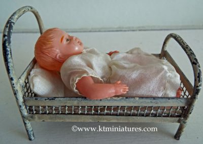 Antique-Short-Metal-Bed-With-Celluloid-Doll